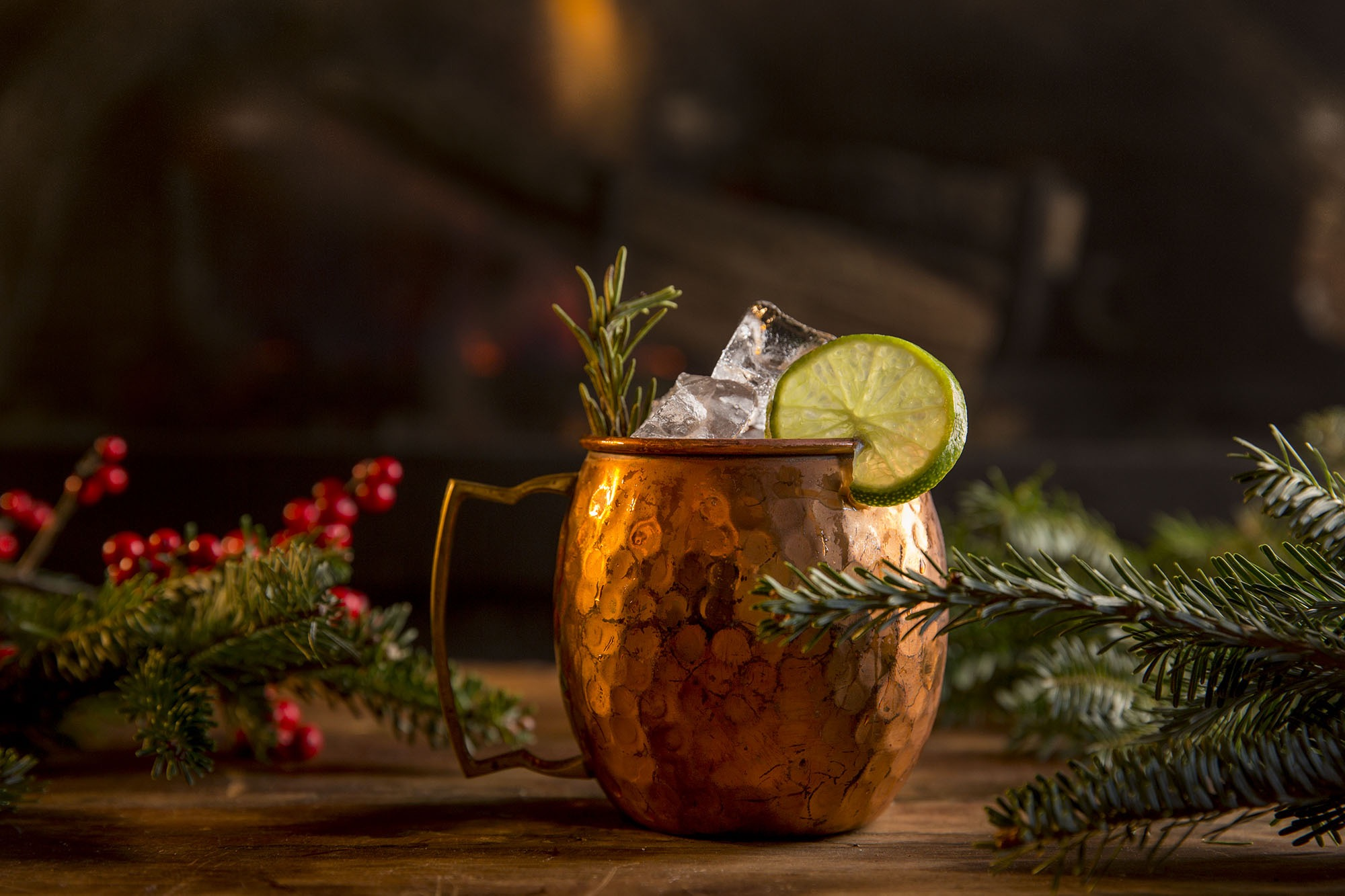 A Moscow mule drink in a festive setting.
