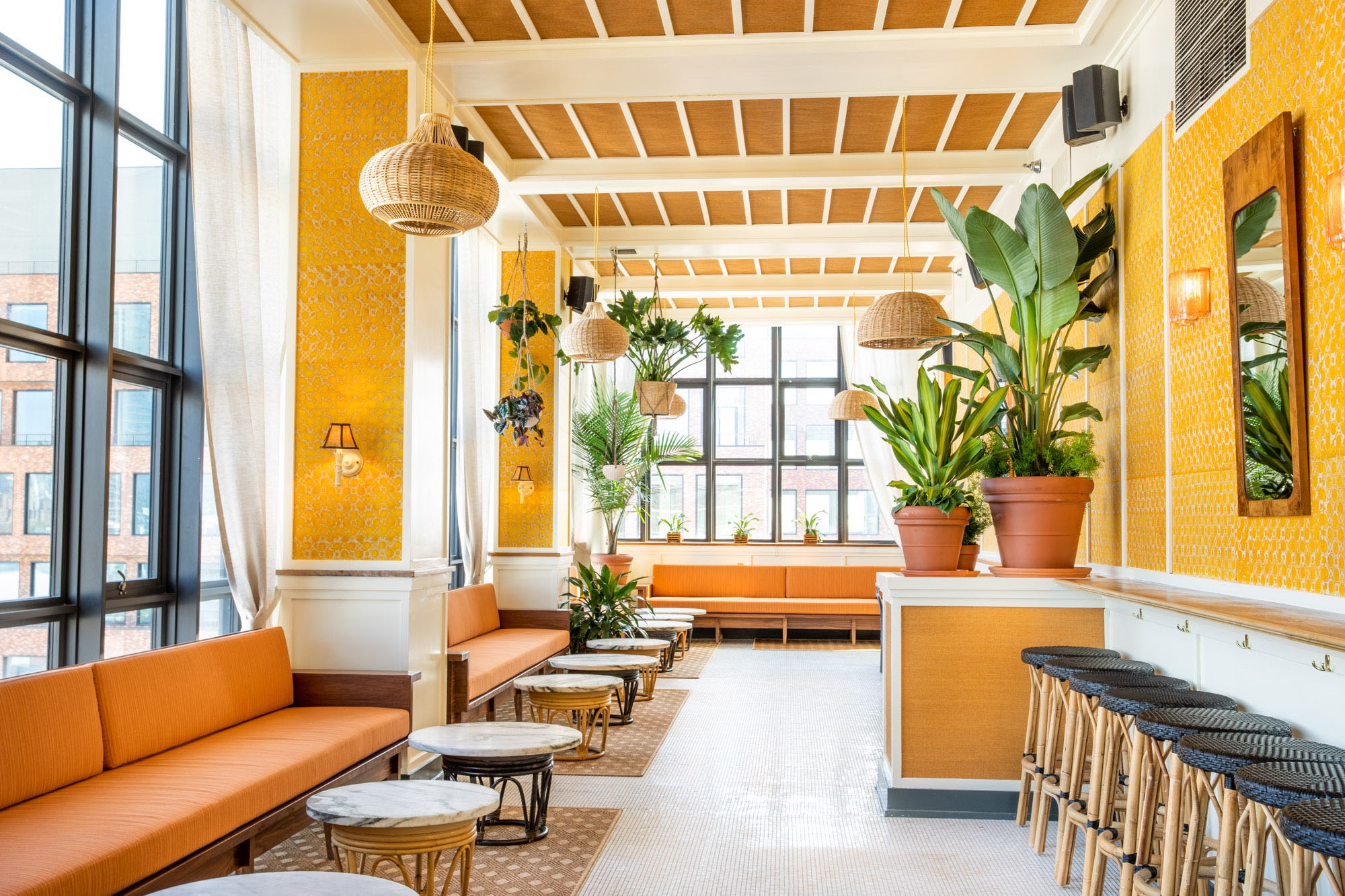 A light airy interior photograph of Lemons, a rooftop bar in the Wythe Hotel.